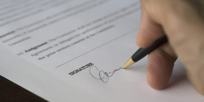 Pictured: signing a real estate lease. Many renters do not know you can re-negotiate the maintenance terms.
